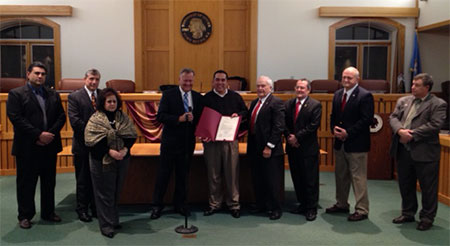 Storeroom Solutions CEO Carlos Tellez receives an official proclamation from the Toms River, N.J. Township Council recognizing the company's contributions to Superstorm Sandy cleanup efforts.